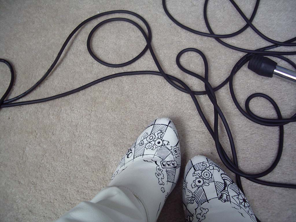 Cogwheel boots and wires on a carpet